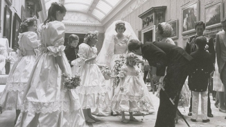 Prince Andrew talks to Diana's young bridesmaid while Prince Charles can be seen on right on frame. (RR Auction)