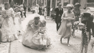 Diana pauses to speak with five-year-old bridesmaid Clementine Hambro.