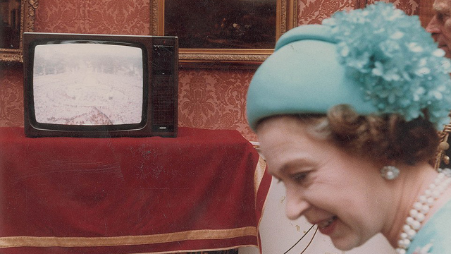 A candid snap of the Queen by a television broadcast of the wedding. (RR Auction)