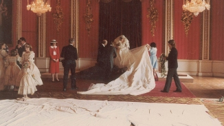 Minders help Diana with the train of her wedding dress. (RR Auction)
