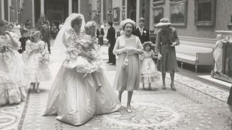 Diana carries her young bridesmaid. (RR Auction)